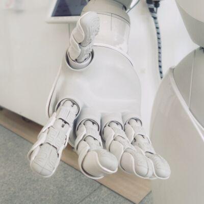 artificial intelligence - robot offering a hand