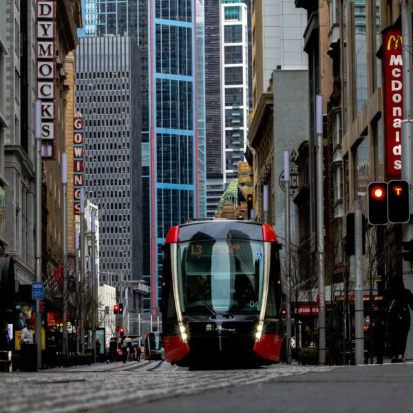 tram travelling on busy street