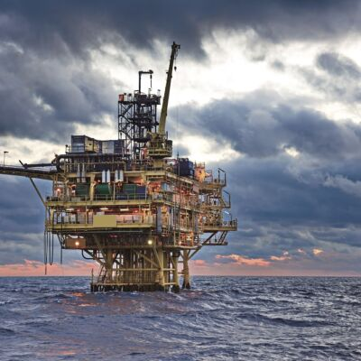 oil rig off shore surrounded by stormy clouds