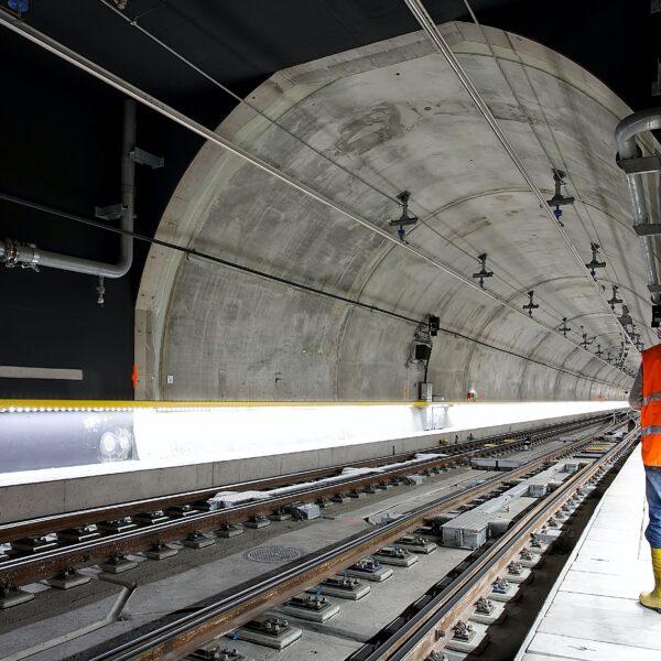 Underground tunnel with man in orange hi-vis