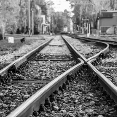 rail tracks crossing in black and white