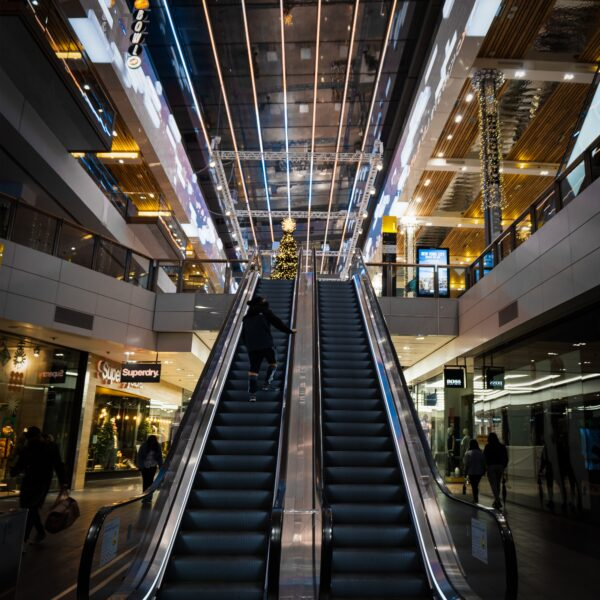 two escalators into a shopping centre mall